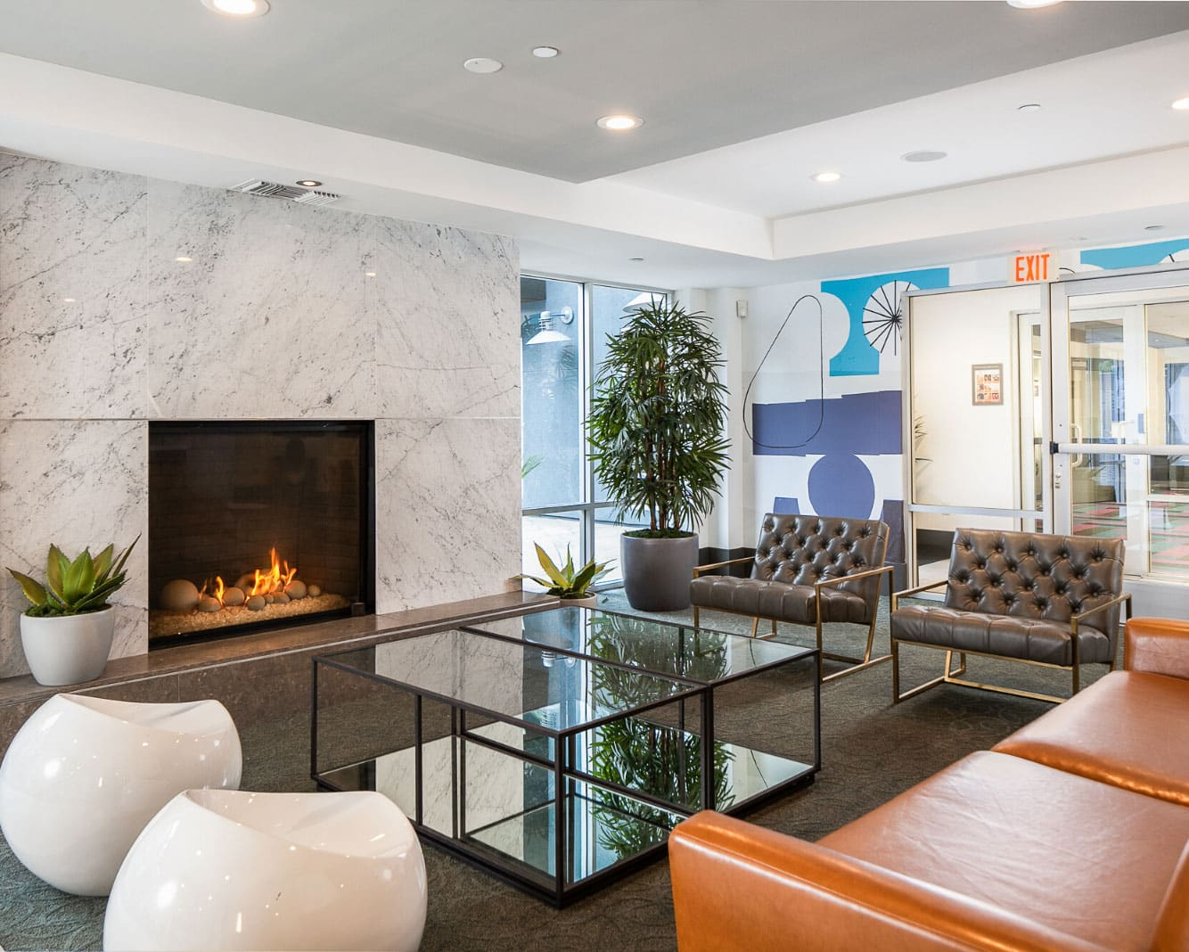Furnished lobby with fireplace and windows