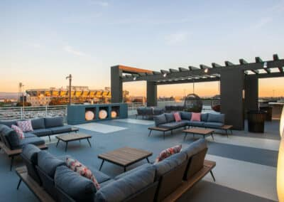 rooftop deck with furniture at sunset