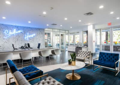 Business center with neon sign on the wall and blue furniture