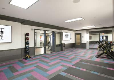 Fitness center with mats and equipment and tv