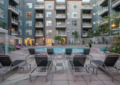Exterior view of apartments with lounge chairs and pool
