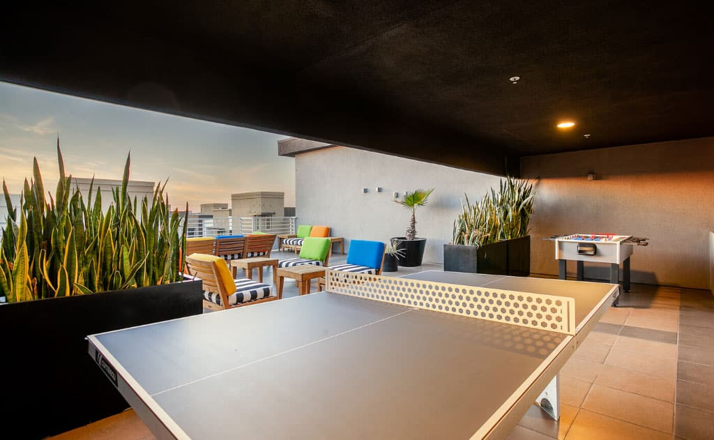 Ping pong and foosball tables on rooftop