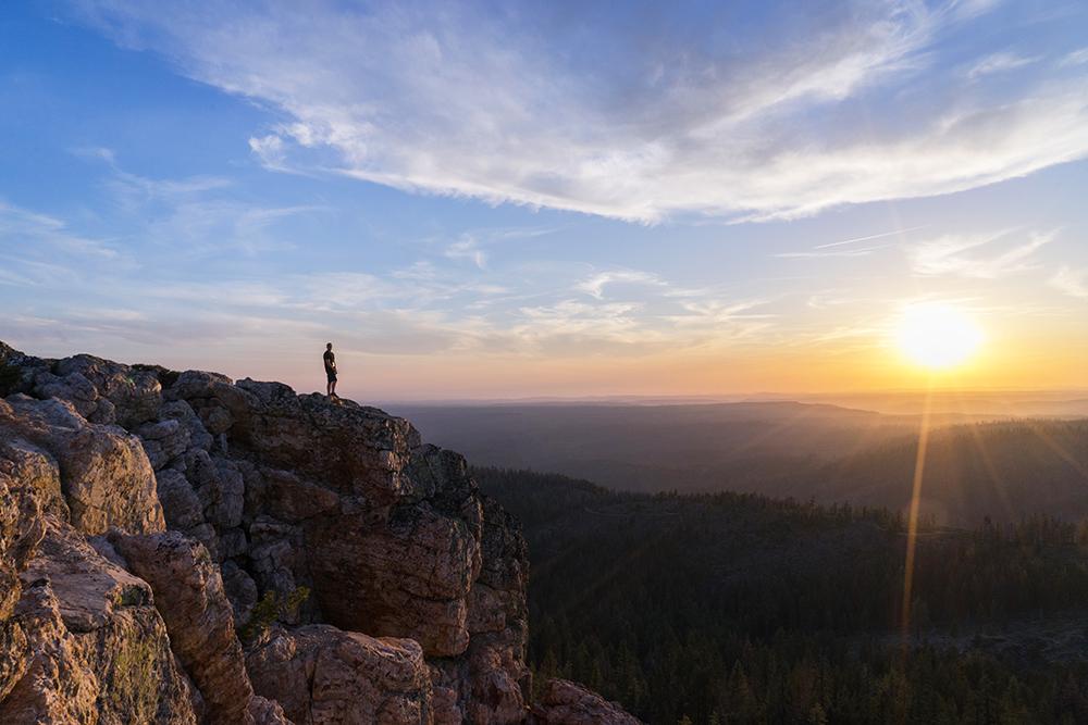 Man on mountain at sunset