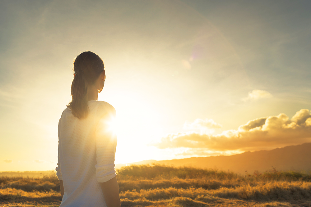 Woman and sunrise