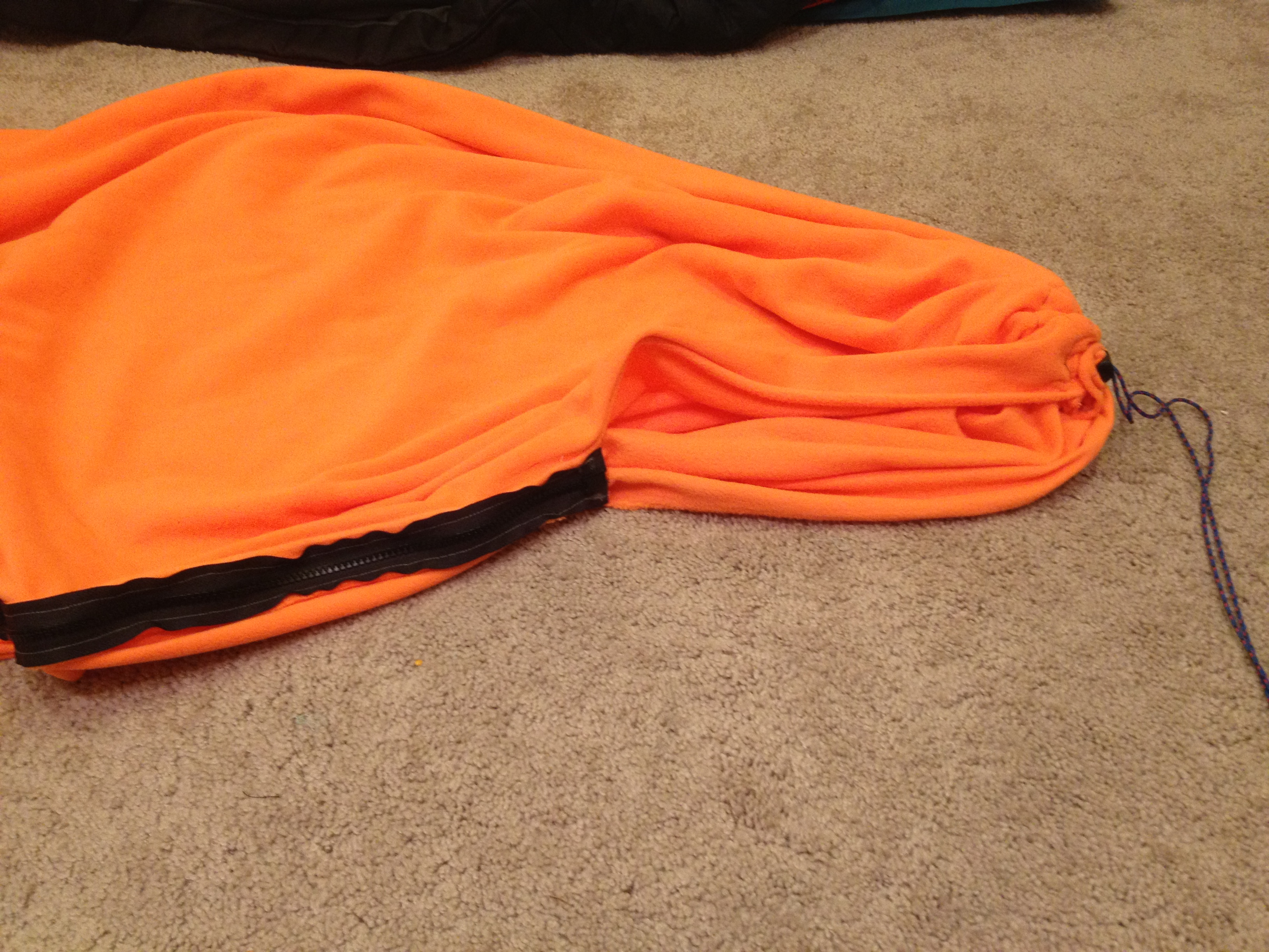 Completed liner, top pulled shut via drawstring