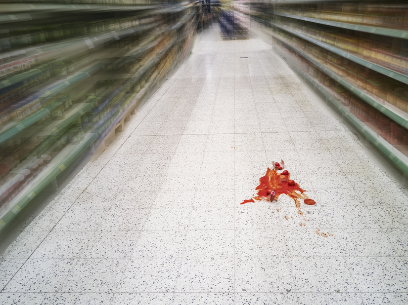 spilled sauce on floor in grocery store