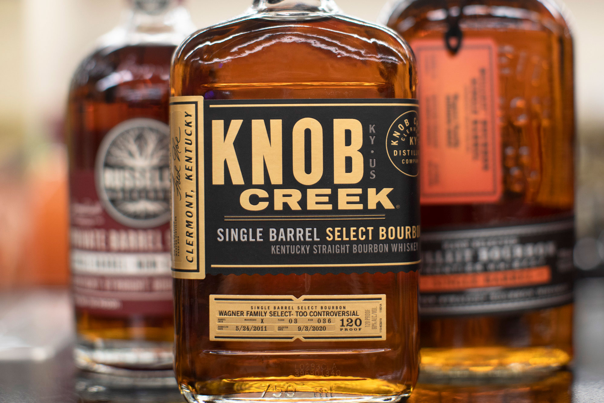 Knob Creek bourbon with Bulleit and Russells Bourbon in background
