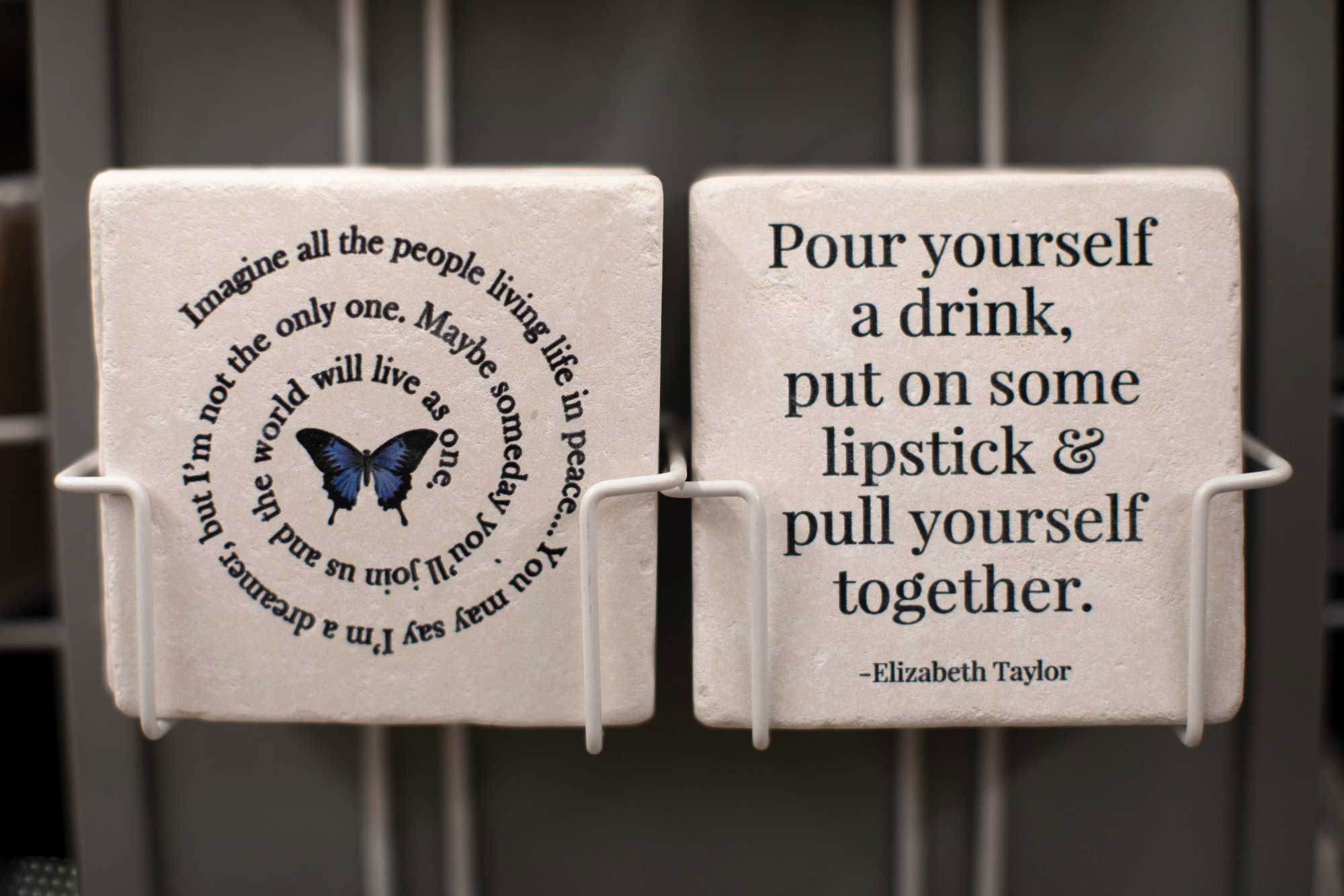 funny sayings coasters on a rack