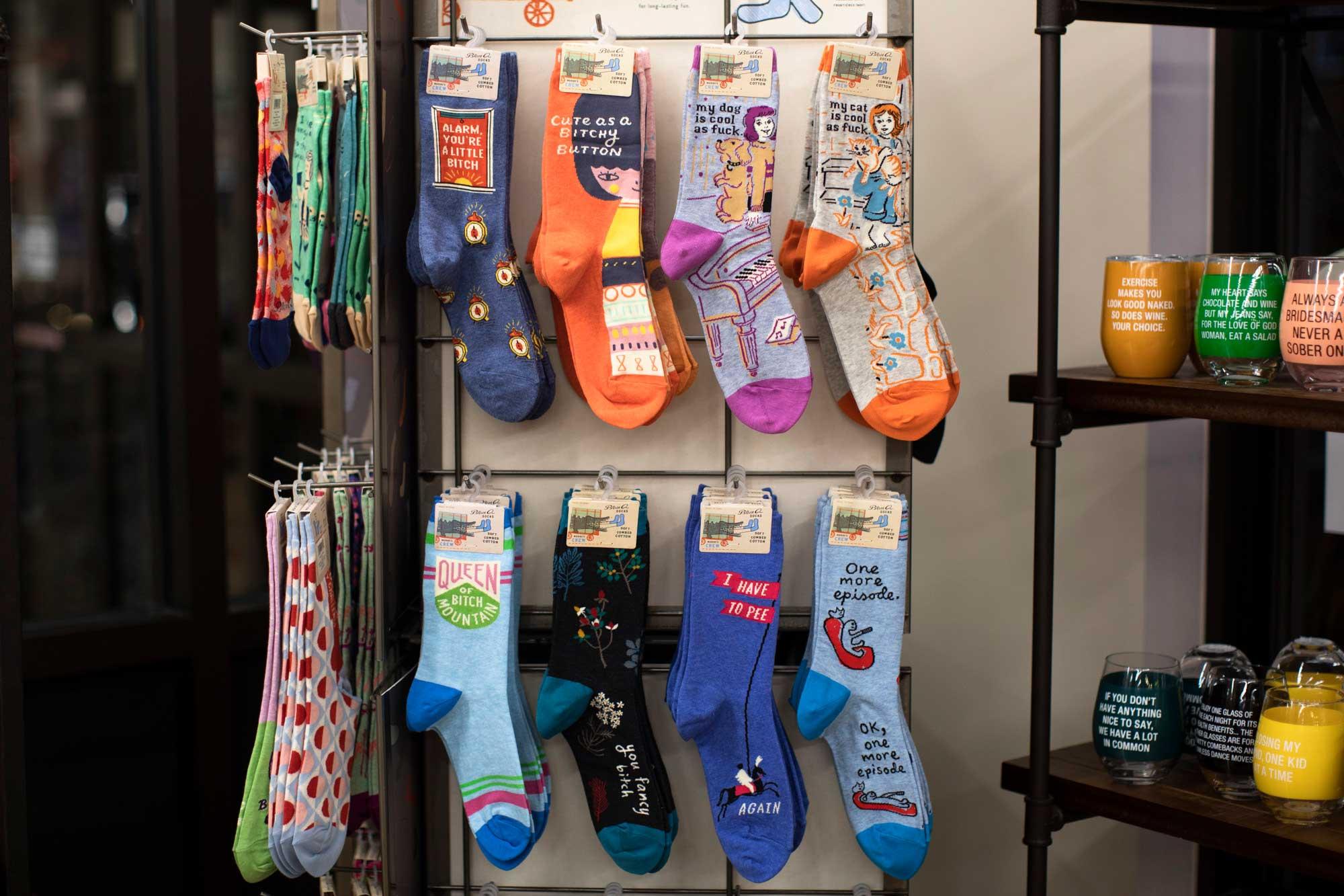 Blue Q socks on a rack
