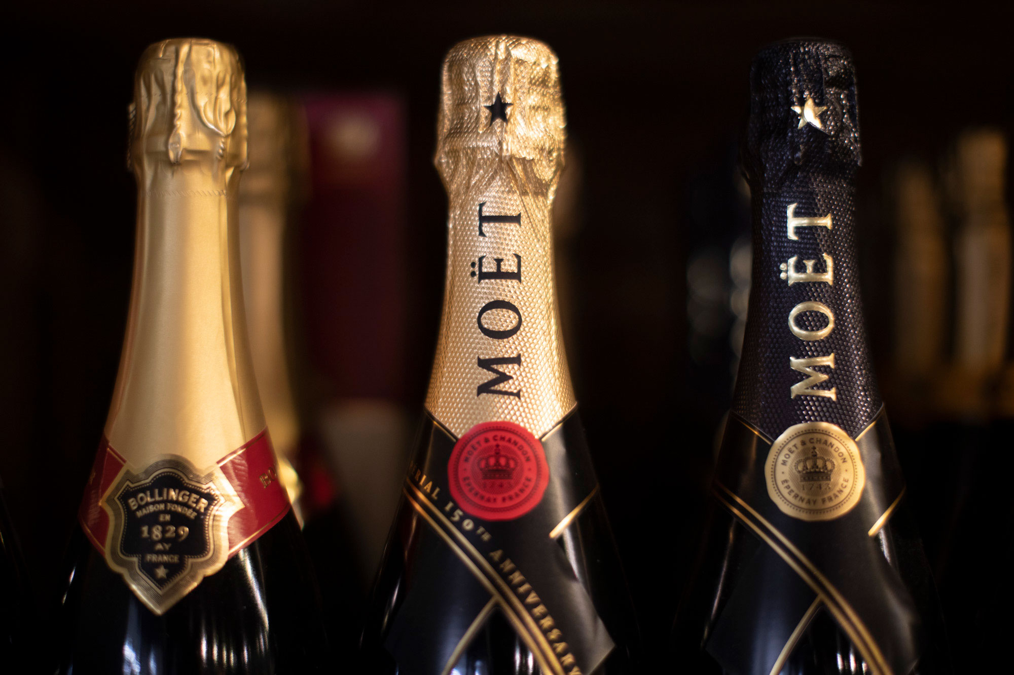 close up of champagne bottles on the shelf