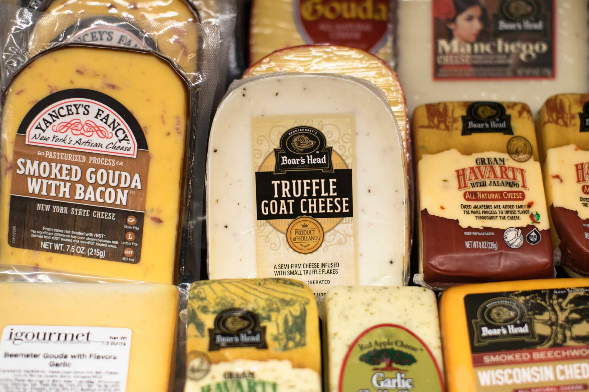 selection of cheeses in specialty foods section