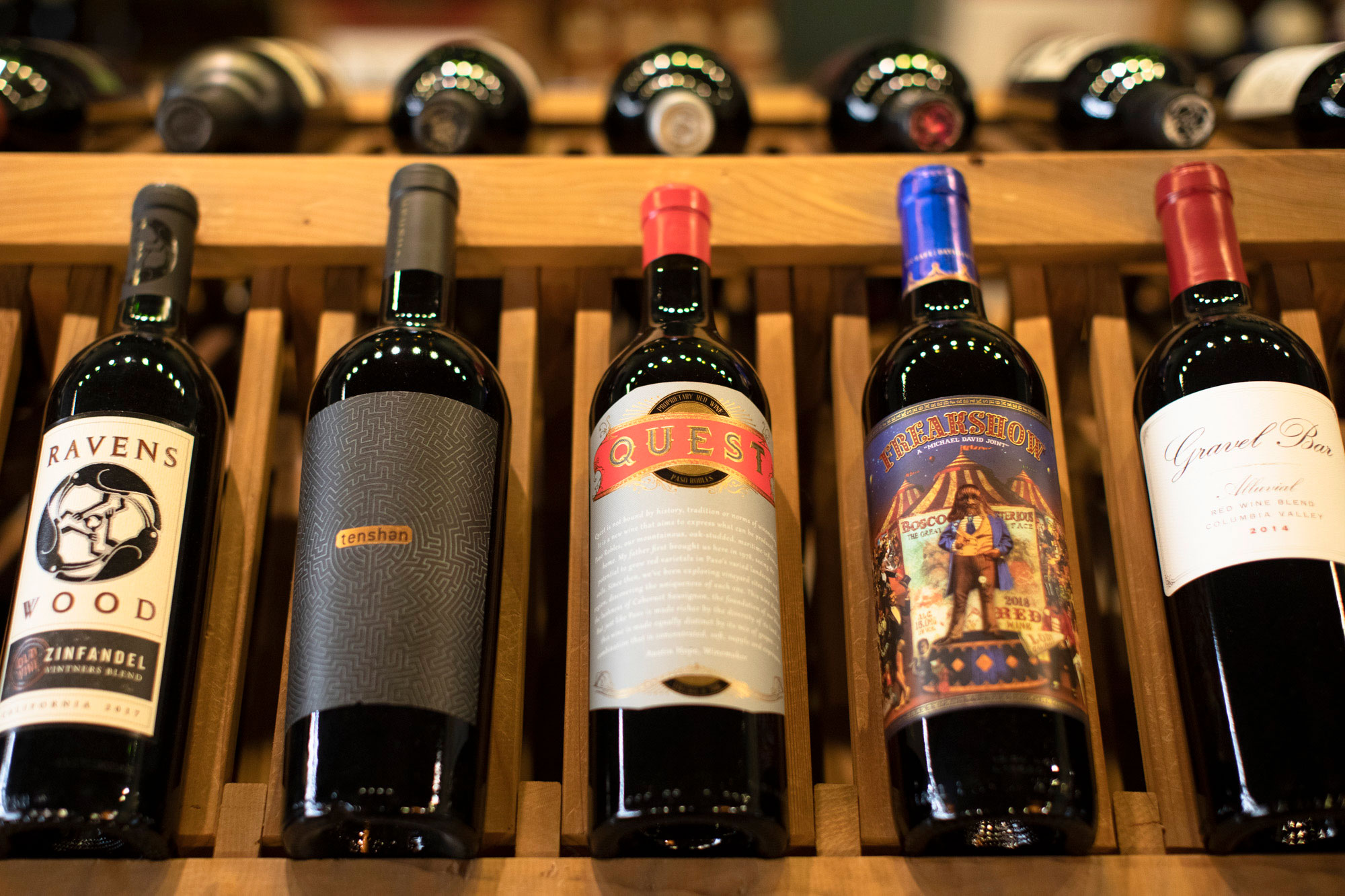 red wine bottle selection on a wine rack