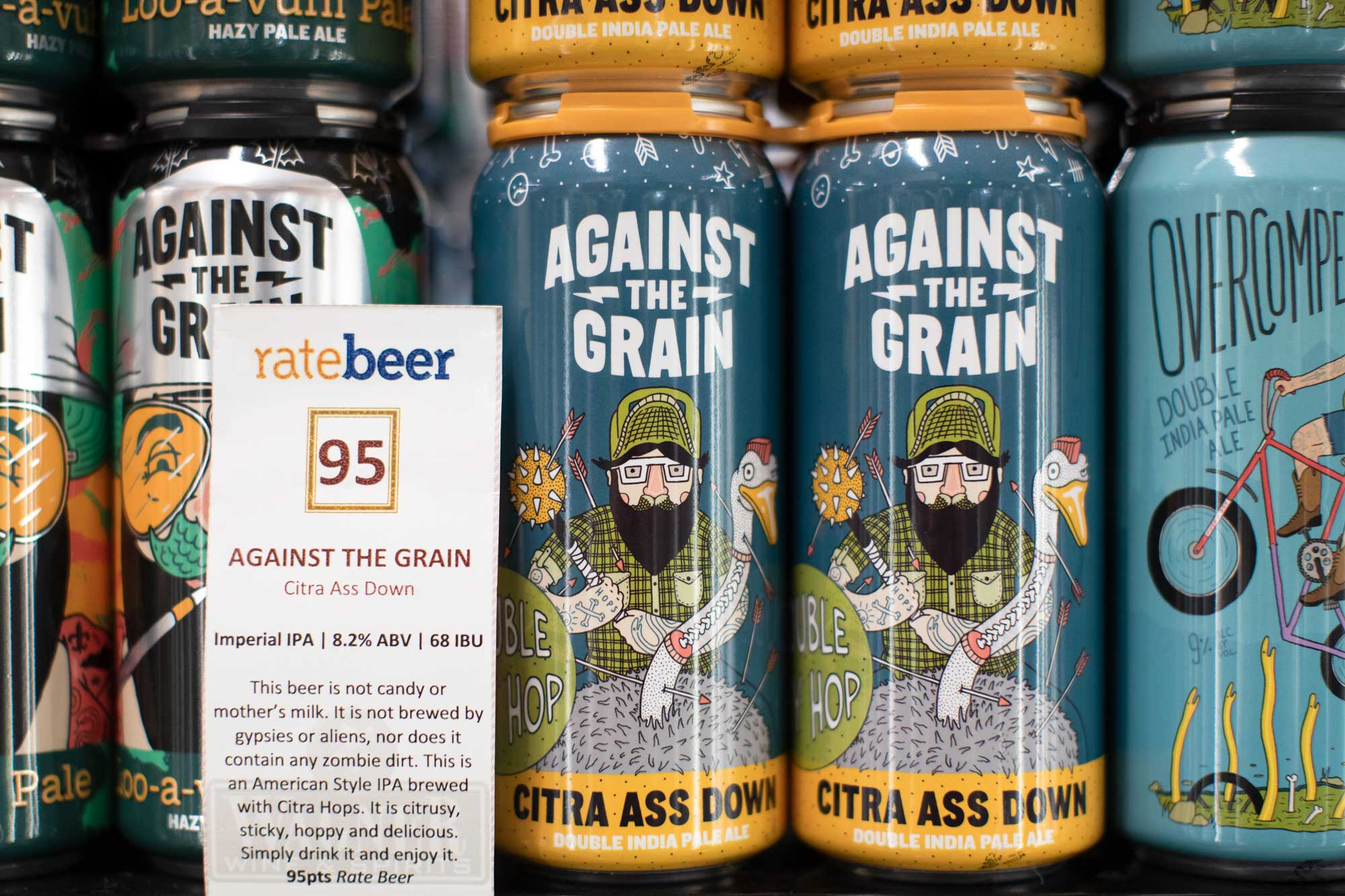 shelf talker with cans of beer