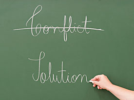 photo of chalkboard crossing out conflict and replacing with resolution