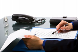 desk of corporate lawyer reviewing legal agreement