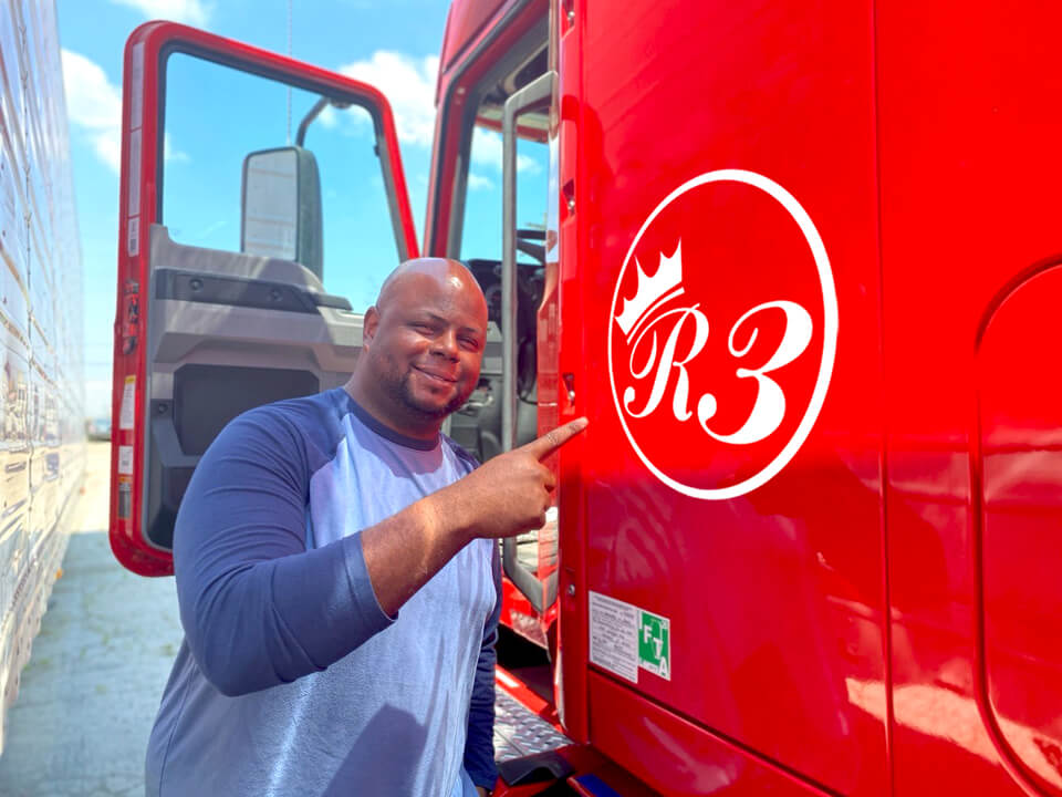Truck driver pointing at Royal3 inc truck