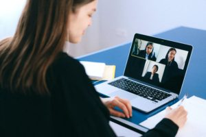 Woman video conferencing on laptop.