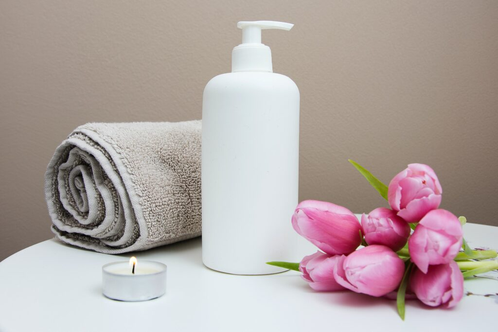 An image of a towel, tulips and cream