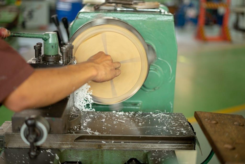 lathe machining a plastic blank