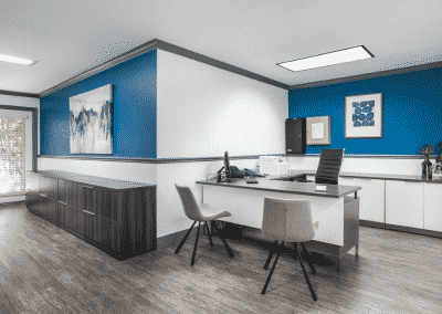White and blue office at The Courtyards with furniture