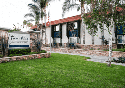Tierra Palms Apartment Homes Sign with grass and landscaping