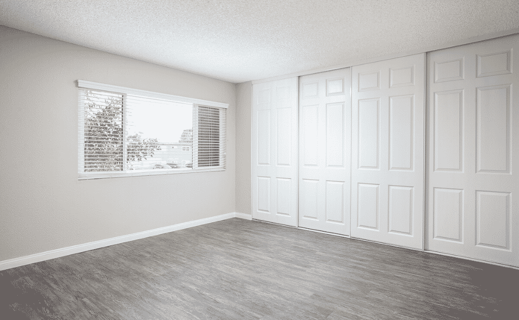 Empty bedroom with windows and closet space