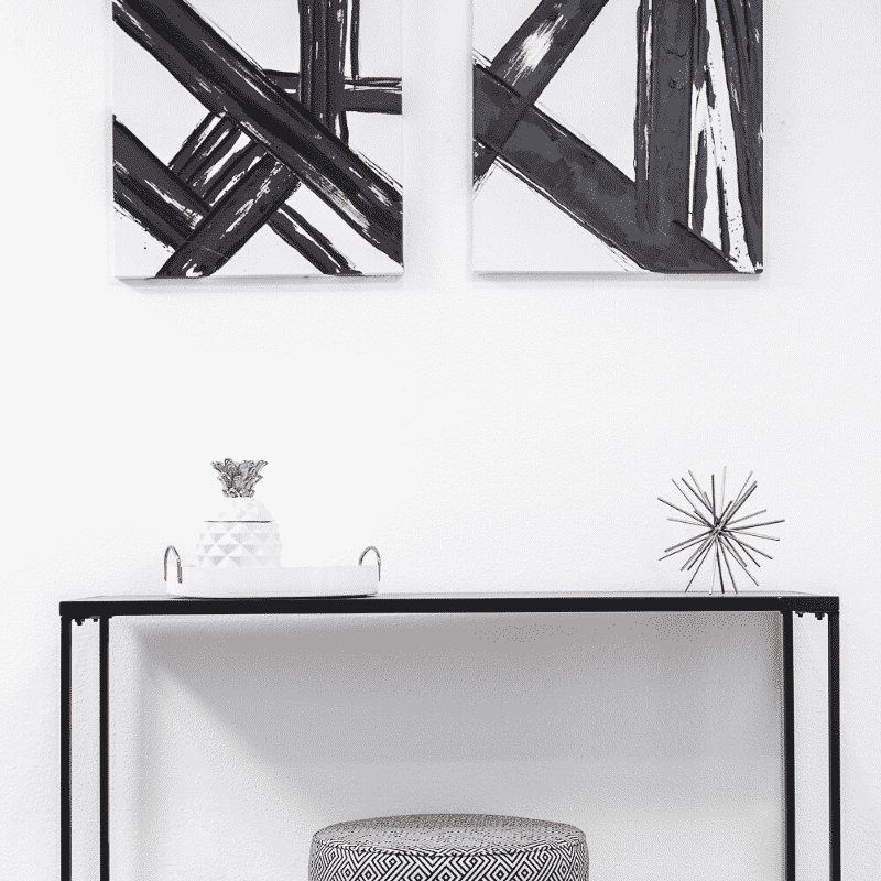 black, white, and gold furniture accents