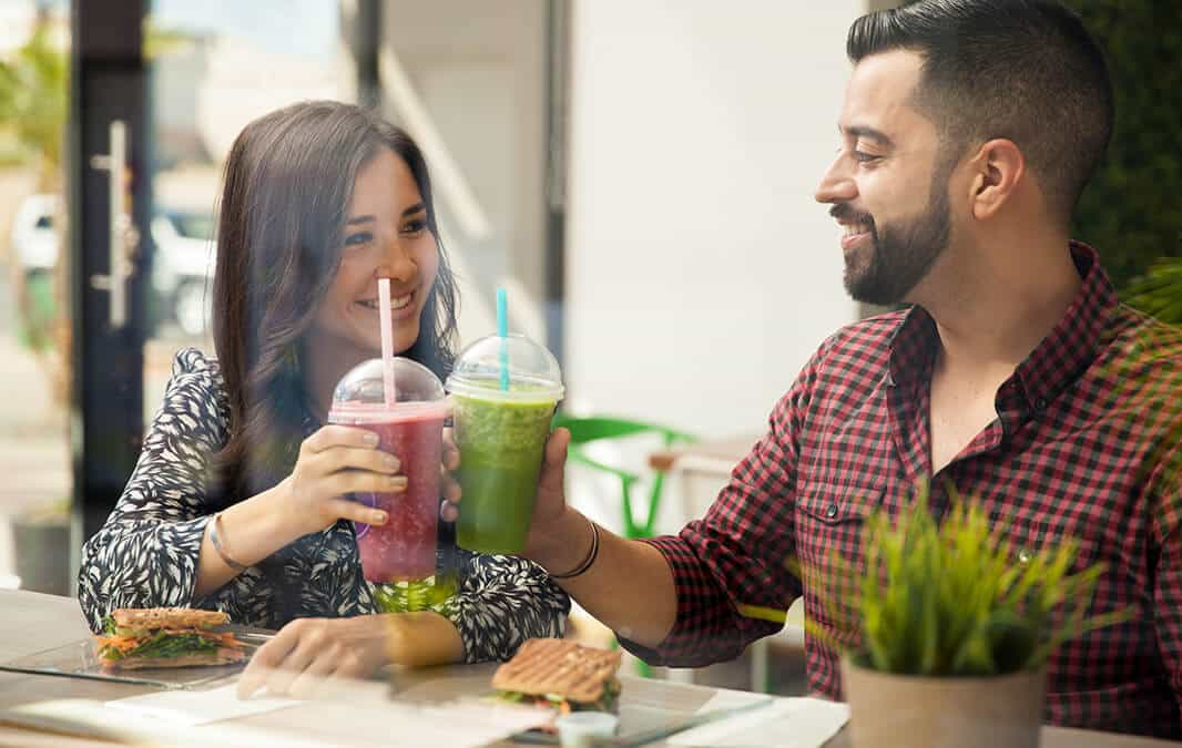 two people having smoothie