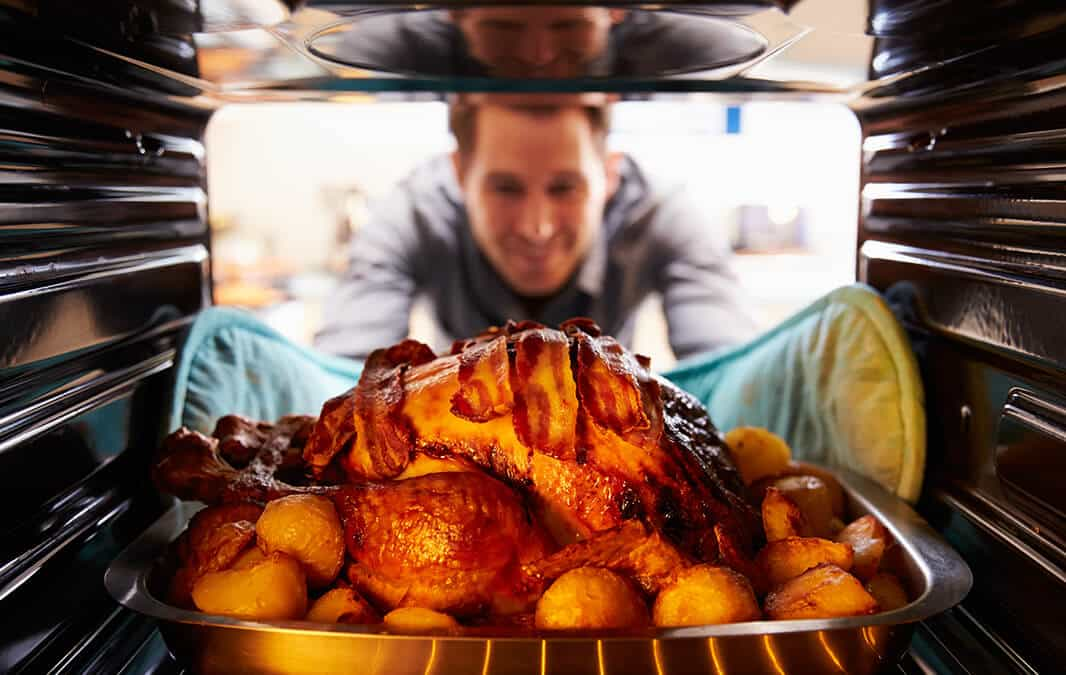 Man Puts Turkey In Oven