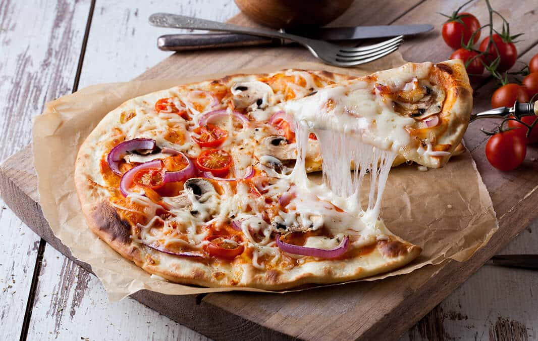 pizza with strings of cheese