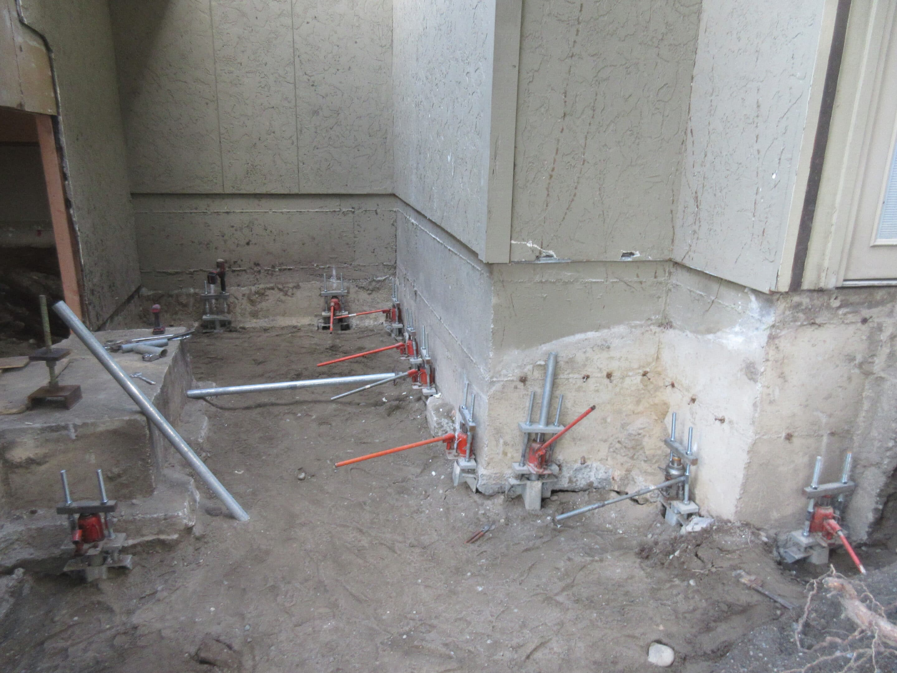 Foundation repair with pipe piles