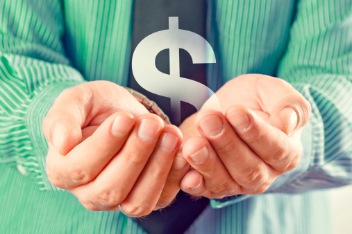 Dollar symbol in hands