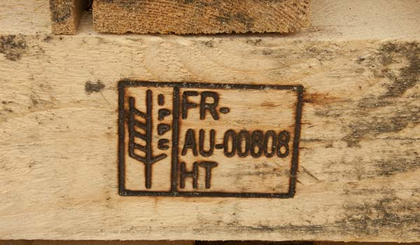 Photograph of a pallet that was branded with an ISPM 15 stamp.