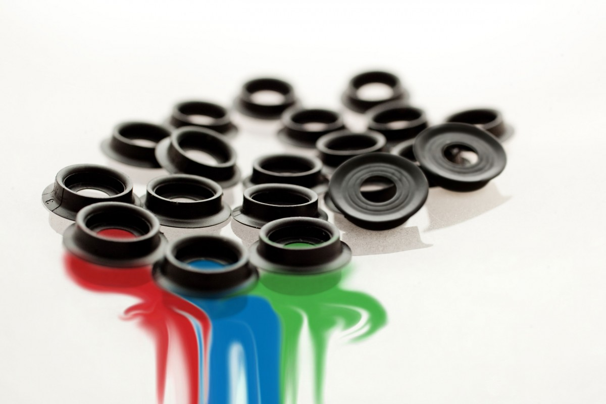 Phone lens housings engineered in part by Art of Mass Production, a San Diego based plastics engineering company