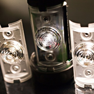 Head lamp parts developed in part by Art of Mass Production, a San Diego based plastics engineering company