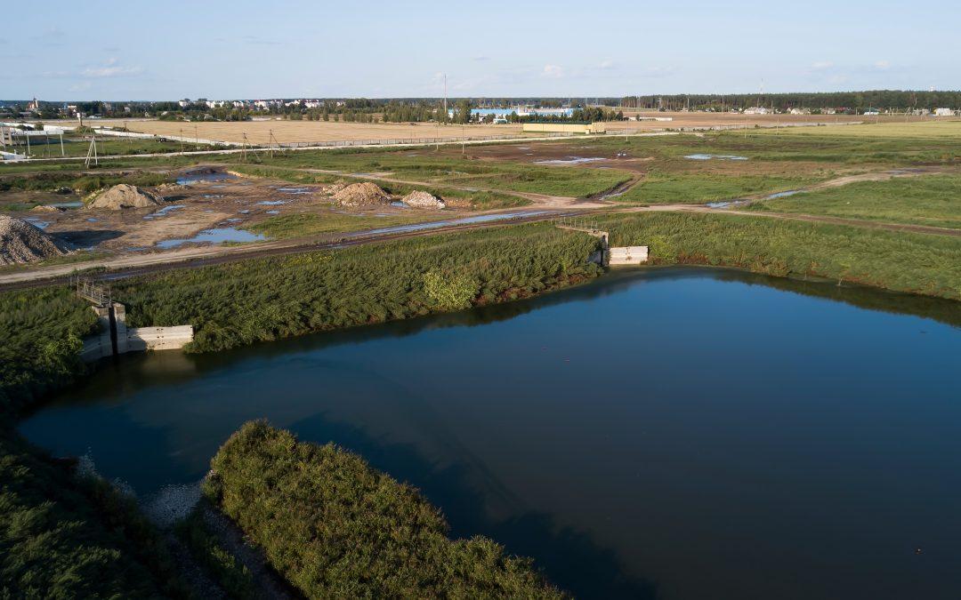 Sludge Reduction in a Large Evaporative Lagoon