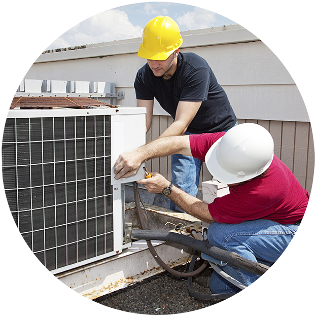 photo of two construction workers upgrading an HVAC unit