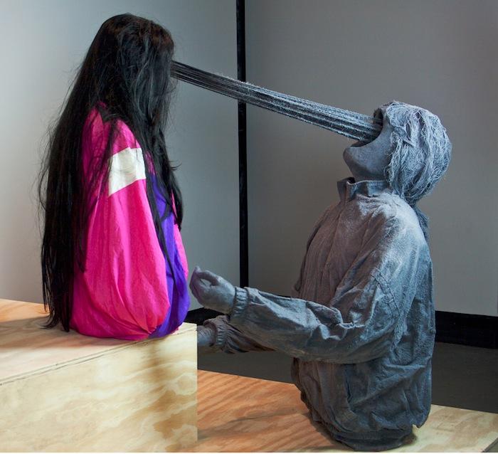 Roxanne Jackson , Title: Don't Stop Believin', 2013 Media: Track jackets, ceramic, wigs, flocking, yarn, cast plaster hands Dimensions: 4 x 3 x 2 feet