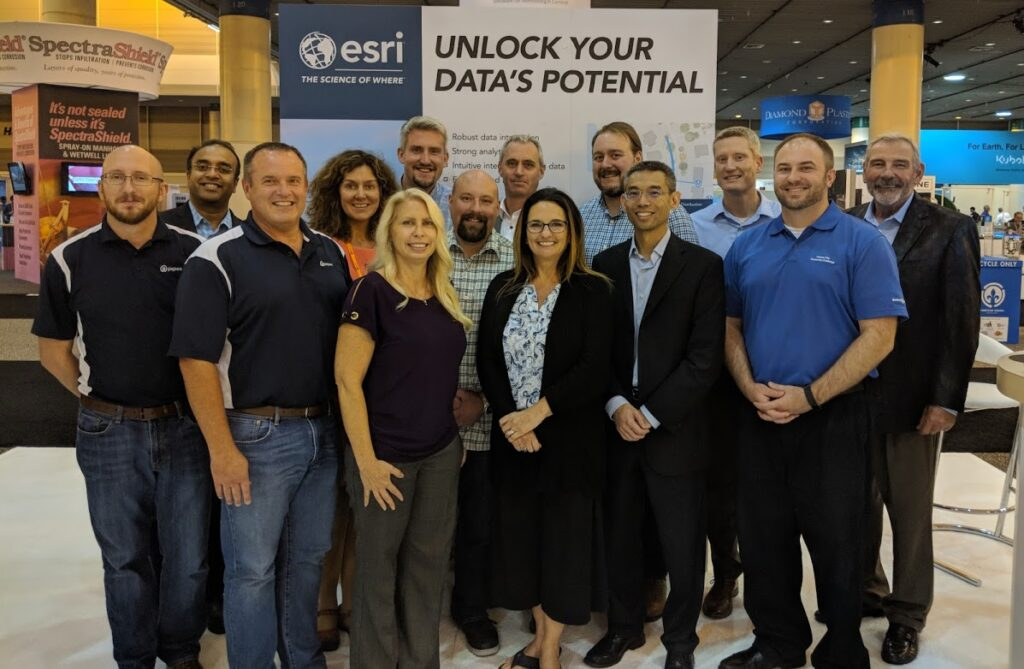 Team members from pipeline inspection software company, ITpipes, pose with partners from Esri and Burns & McDonald.