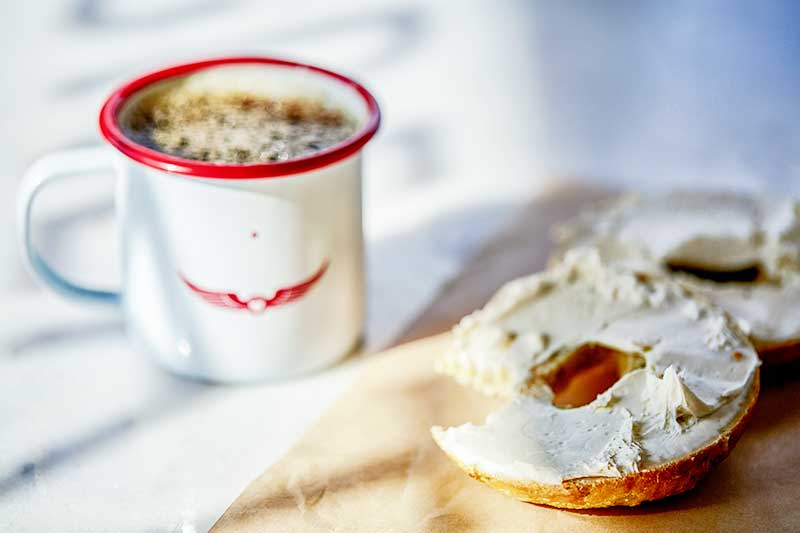coffee and bagel with cream cheese. Great Bagel & Bakery in Lexington, KY