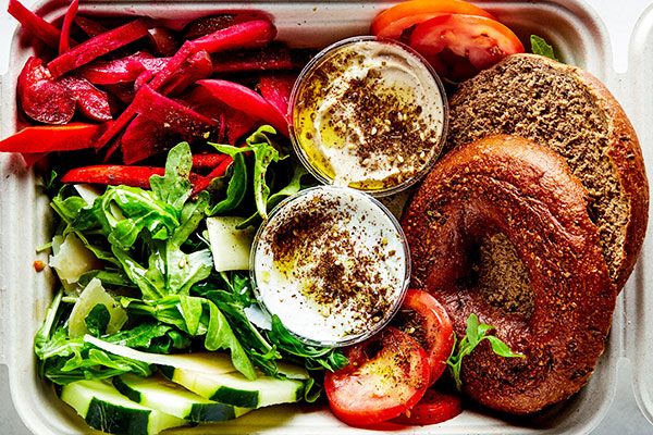 Mediterranean Plate: Savory bagel platter and green salad catering from Great Bagel & Bakery in Lexington, KY