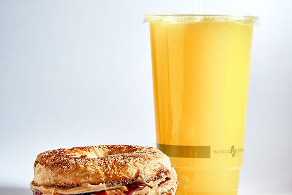 orange juice and PB&J bagel sandwich