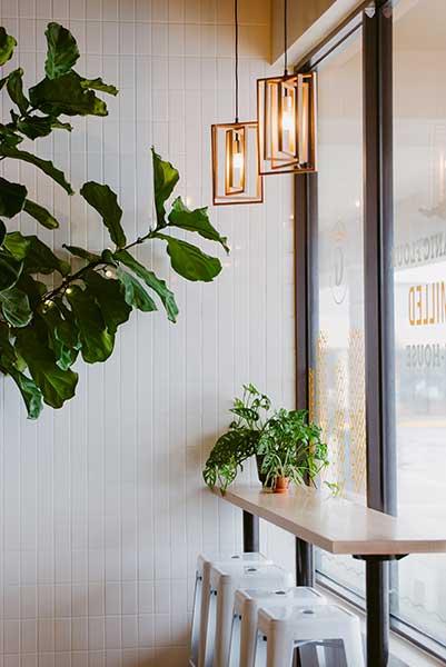 Great Bagel & Bakery, Boston Road dining counter. Boho decor. Plants.
