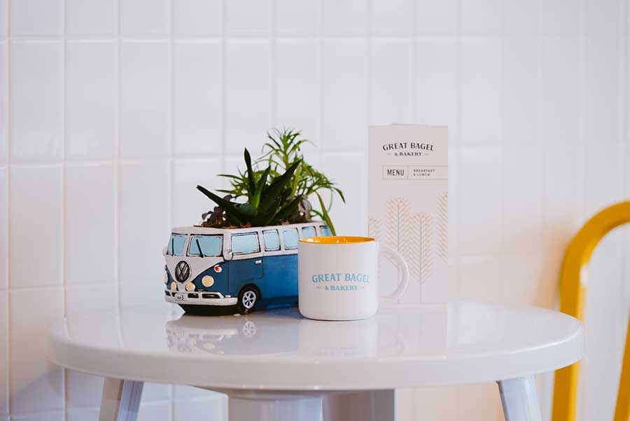 Great Bagel & Bakery, Boston Road dining table with VW bus planter