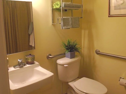 A bathroom in Azalea Gardens resort residence with