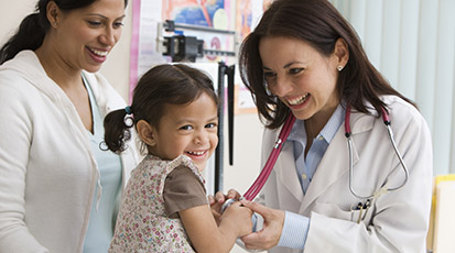 Doctor with Smiling Child and Mother