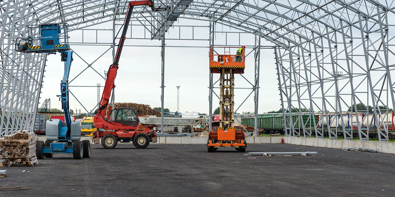 Lift with platform work in warehouse hangar construction field.
