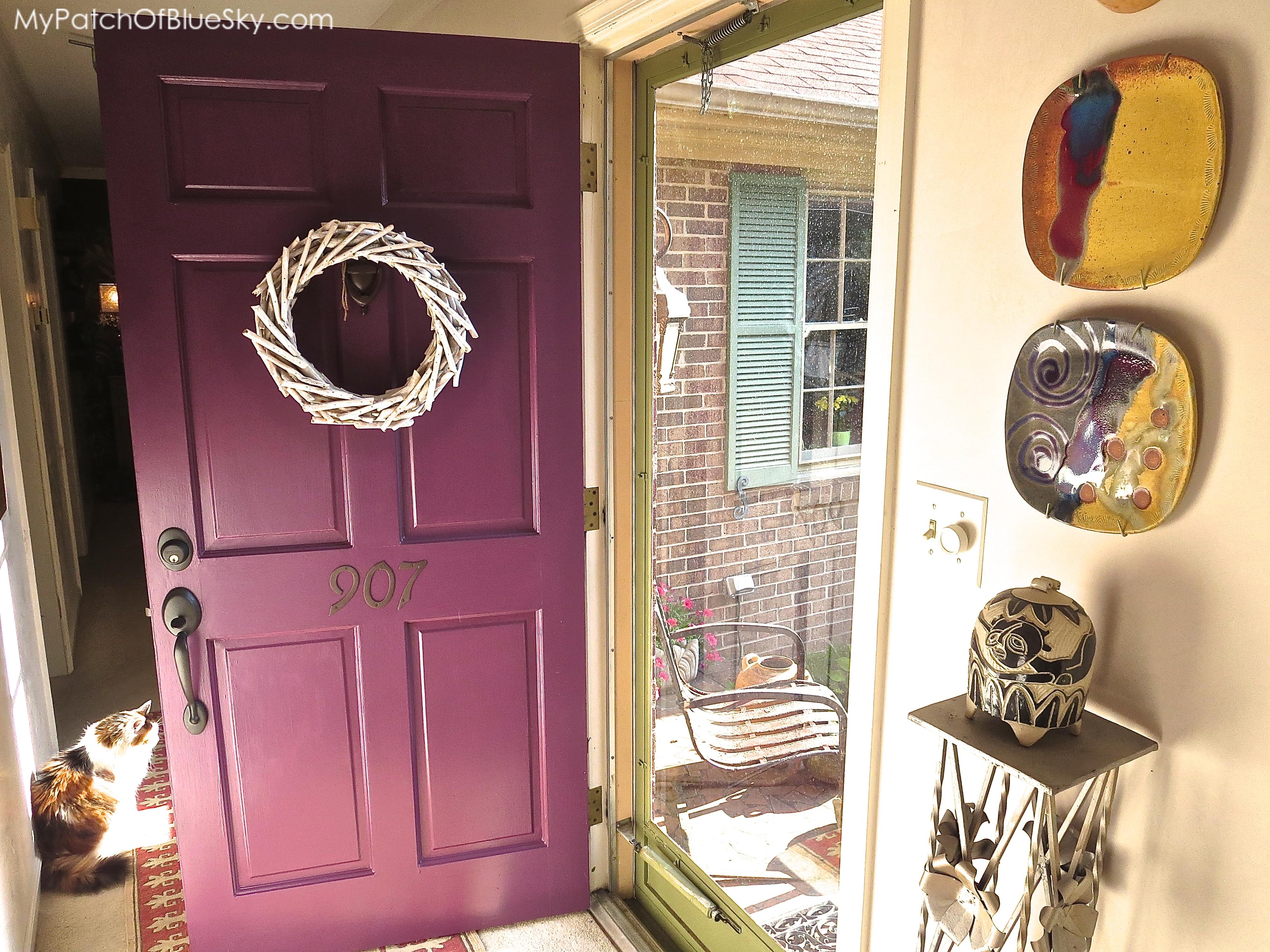 Painted front door with artwork.