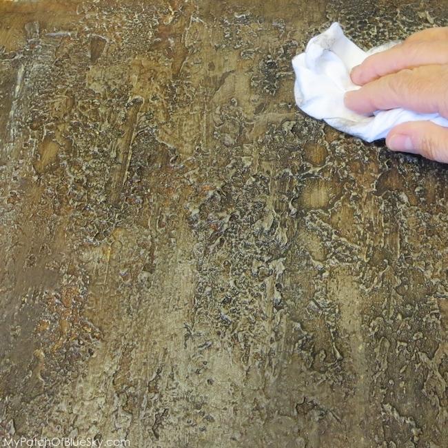 Photo of wiping back bark finish.
