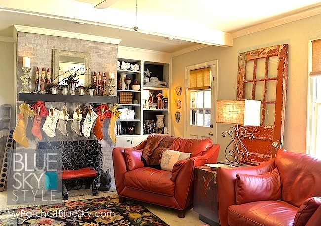 Our red leather den is perfect with a simple decorated mantel